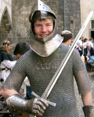 Ryan Mitchell doning medieval armour at Prague Castle on Scouting exchange